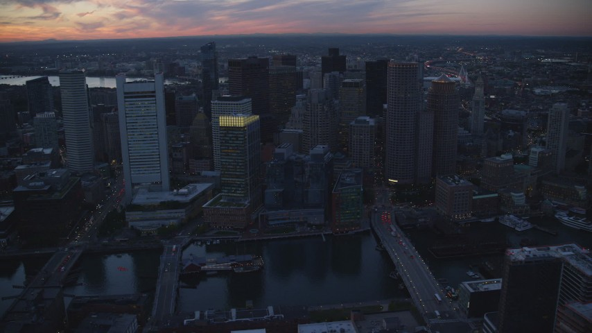 6k stock footage aerial video flying by skyscrapers, Downtown Boston, Massachusetts, sunset Aerial Stock Footage | AX146_126
