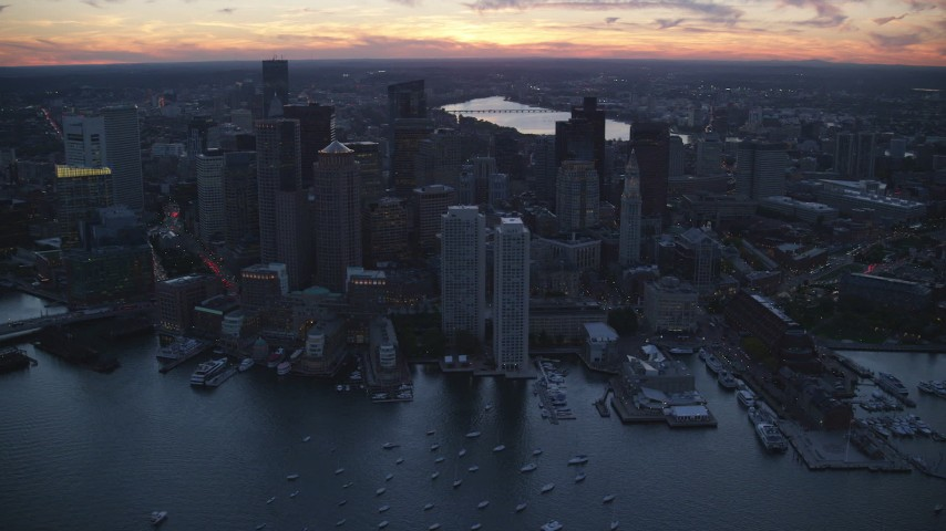 6k stock footage aerial video flying by buildings and skyscrapers, Downtown Boston, Massachusetts, twilight Aerial Stock Footage | AX146_128