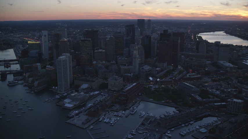 6k stock footage aerial video flying by skyscrapers and buildings, Downtown Boston, Massachusetts, twilight Aerial Stock Footage | AX146_129