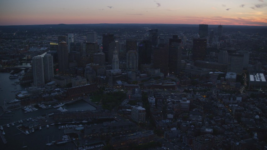 6k stock footage aerial video flying by skyscrapers, Downtown Boston, Massachusetts, twilight Aerial Stock Footage | AX146_130
