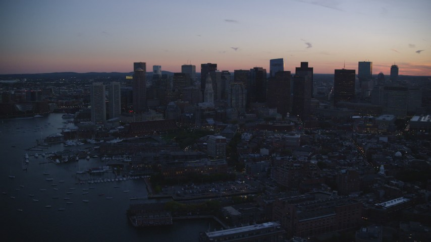 6k stock footage aerial video flying by the skyline, Downtown Boston, Massachusetts, twilight Aerial Stock Footage | AX146_132
