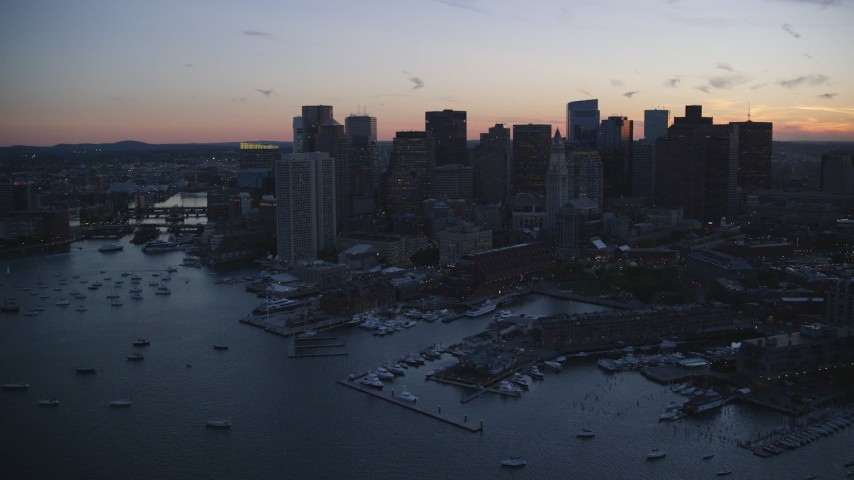 6k stock footage aerial video flying by the downtown skyline, Downtown Boston, Massachusetts, twilight Aerial Stock Footage | AX146_133