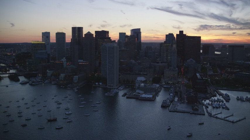 6k stock footage aerial video flying by Rowes Wharf and skyscrapers, Downtown Boston, Massachusetts, twilight Aerial Stock Footage | AX146_134