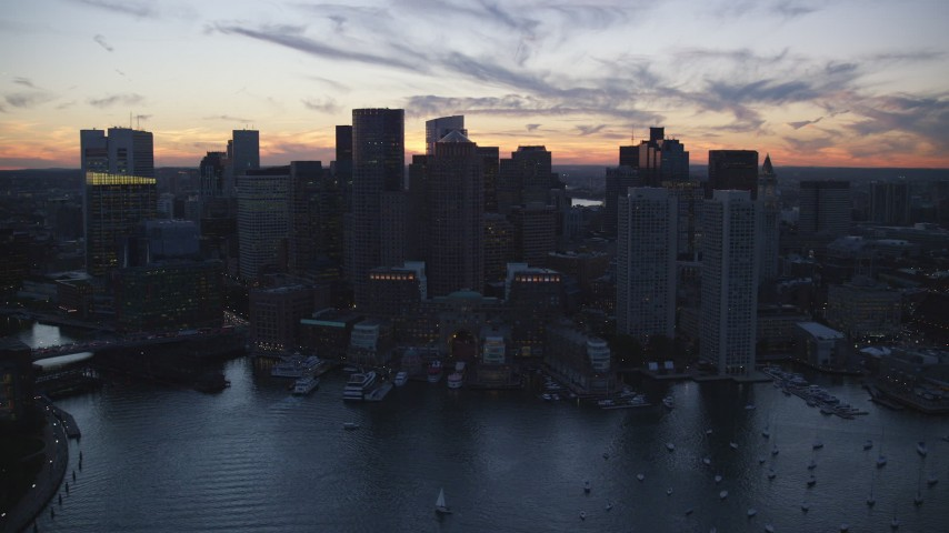 6k stock footage aerial video flying by Rowes Wharf, skyline, Downtown Boston, Massachusetts, twilight Aerial Stock Footage | AX146_135