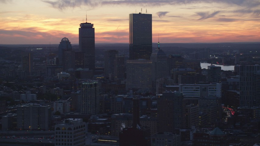 6k stock footage aerial video flying by downtown buildings, skyscrapers, Downtown Boston, Massachusetts, twilight Aerial Stock Footage | AX146_137