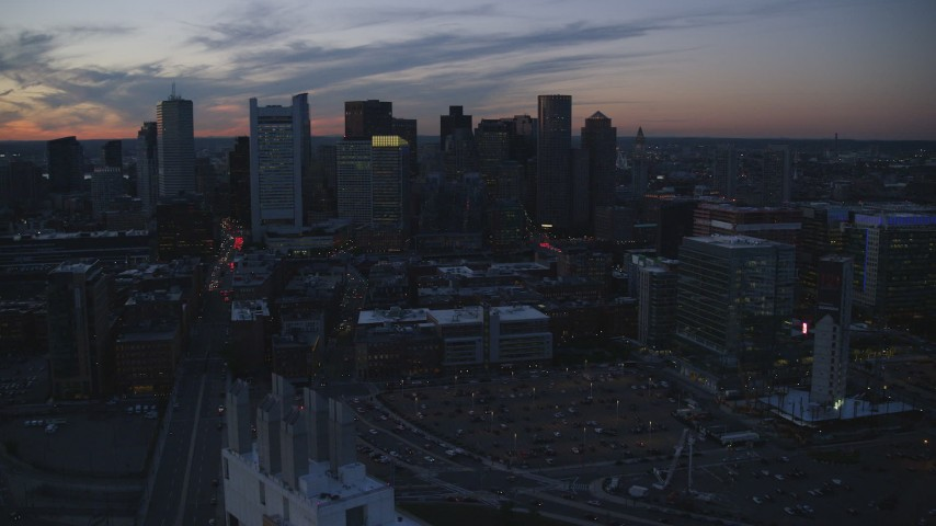 6k stock footage aerial video approaching skyline and office buildings, Downtown Boston, Massachusetts, twilight Aerial Stock Footage | AX146_139