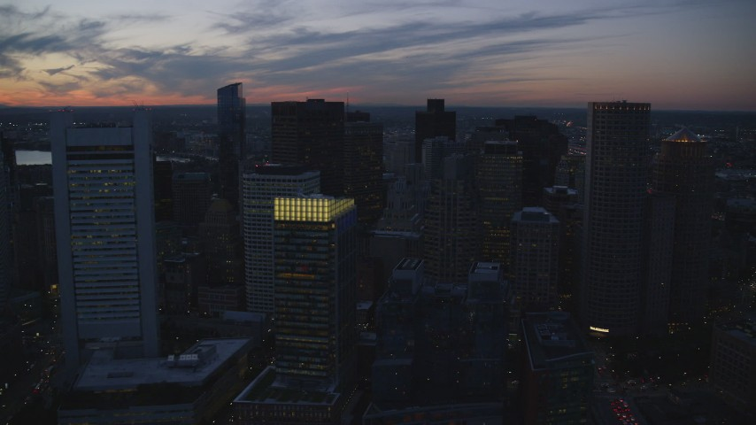 6k stock footage aerial video flying over skyscrapers, tilting down, Downtown Boston, Massachusetts, twilight Aerial Stock Footage | AX146_141