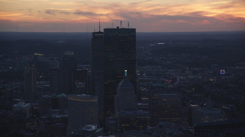 6k stock footage aerial video flying by skyscrapers, Downtown Boston, Massachusetts, twilight Aerial Stock Footage | AX146_142