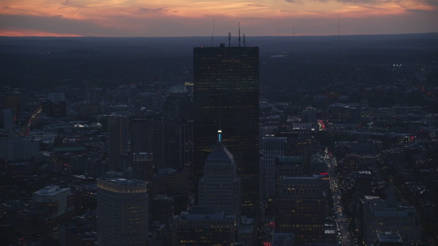 6k stock footage aerial video flying by skyscrapers Downtown Boston, Massachusetts, twilight Aerial Stock Footage | AX146_143
