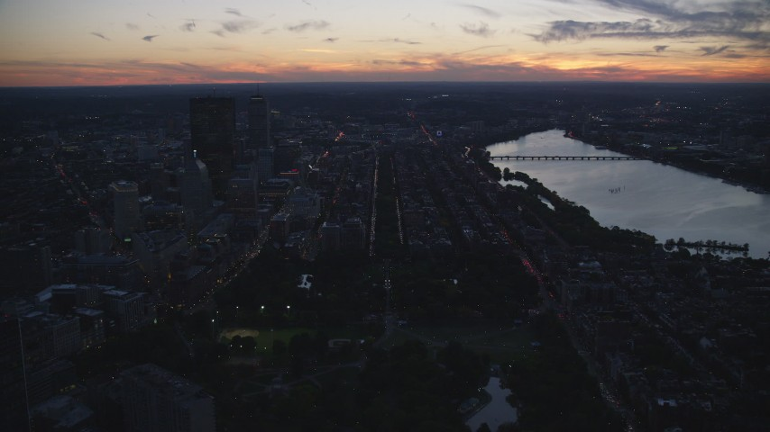 6k stock footage aerial video approaching skyscrapers, Back Bay row houses, Downtown Boston, Massachusetts, twilight Aerial Stock Footage | AX146_144
