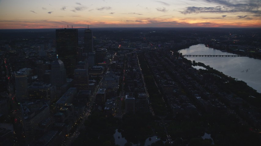 6k stock footage aerial video Back Bay row houses and skyscrapers, Downtown Boston, Massachusetts, twilight Aerial Stock Footage | AX146_145