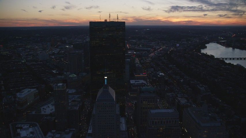 6k stock footage aerial video flying by downtown buildings, skyscrapers, Downtown Boston, Massachusetts, twilight Aerial Stock Footage | AX146_146