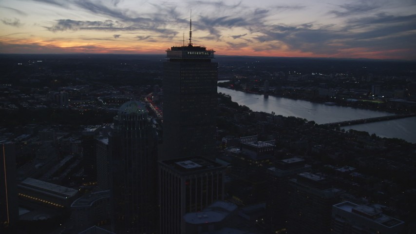 6k stock footage aerial video flying by skyscrapers, buildings, Downtown Boston, Massachusetts, twilight Aerial Stock Footage | AX146_147