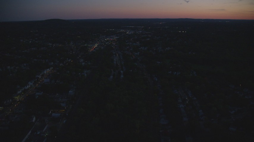 6k stock footage aerial video flying over suburban neighborhood, Hyde Park, Massachusetts, night Aerial Stock Footage | AX146_157