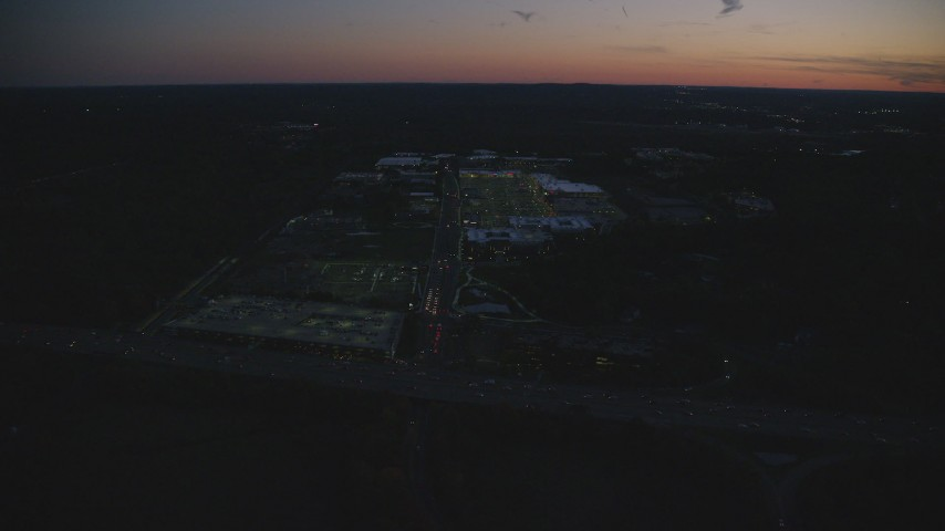 6k stock footage aerial video approaching an office building and tilt down, Westwood, Massachusetts, night Aerial Stock Footage | AX146_163