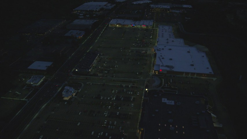 6k stock footage aerial video flying over office buildings, approach strip mall, Westwood, Massachusetts, night Aerial Stock Footage | AX146_164