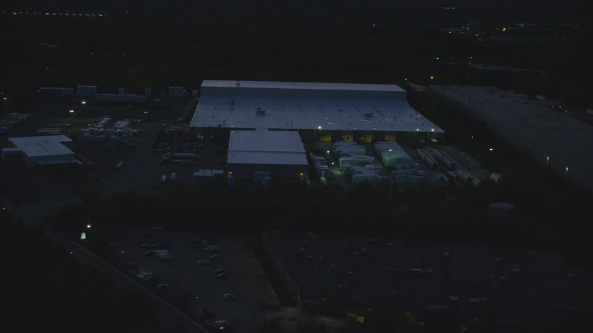 6k stock footage aerial video flying by a warehouse, Westwood, Massachusetts, night Aerial Stock Footage AX146_166 | Axiom Images
