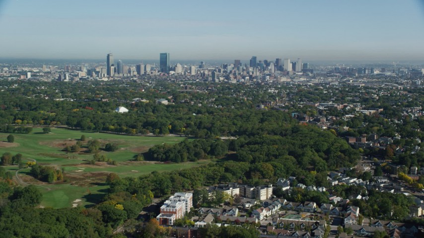 6k stock footage aerial video approaching Downtown Boston city sprawl and skyline, Massachusetts Aerial Stock Footage | AX147_002