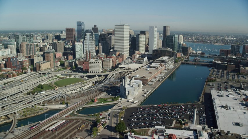 6k stock footage aerial video flying along Downtown Boston skyscrapers toward Fort Point Channel, Massachusetts Aerial Stock Footage | AX147_007