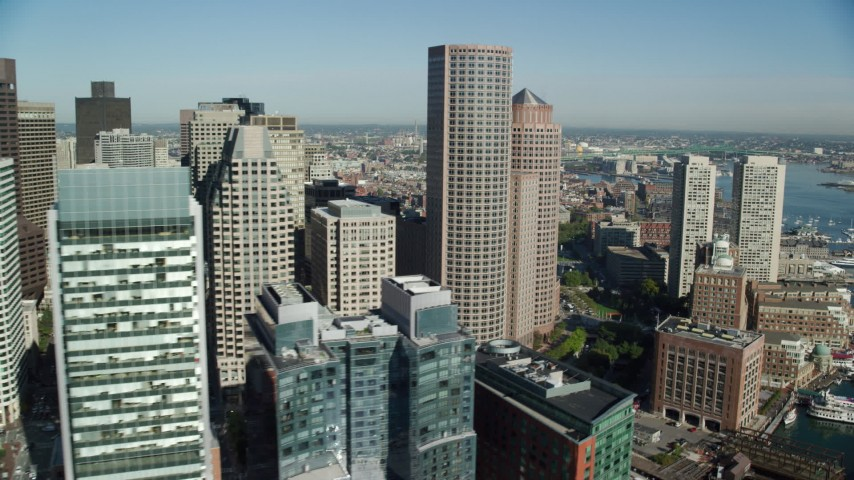 6k stock footage aerial video flying by Downtown Boston skyscrapers, Massachusetts Aerial Stock Footage | AX147_008