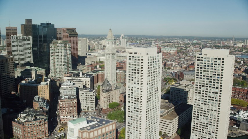 6k stock footage aerial video flying by skyscrapers and Custom House Tower, Downtown Boston, Massachusetts Aerial Stock Footage | AX147_009