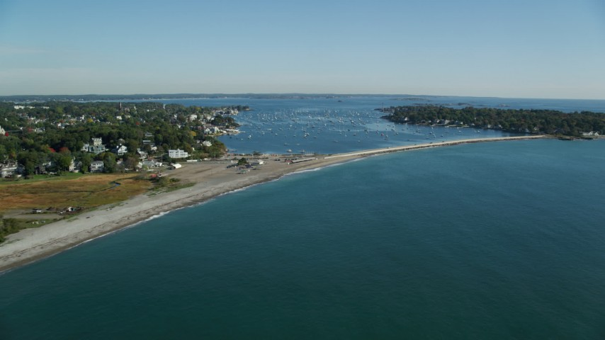 6k stock footage aerial video approaching Marblehead Harbor and coastal community among trees, Marblehead, Massachusetts Aerial Stock Footage | AX147_023