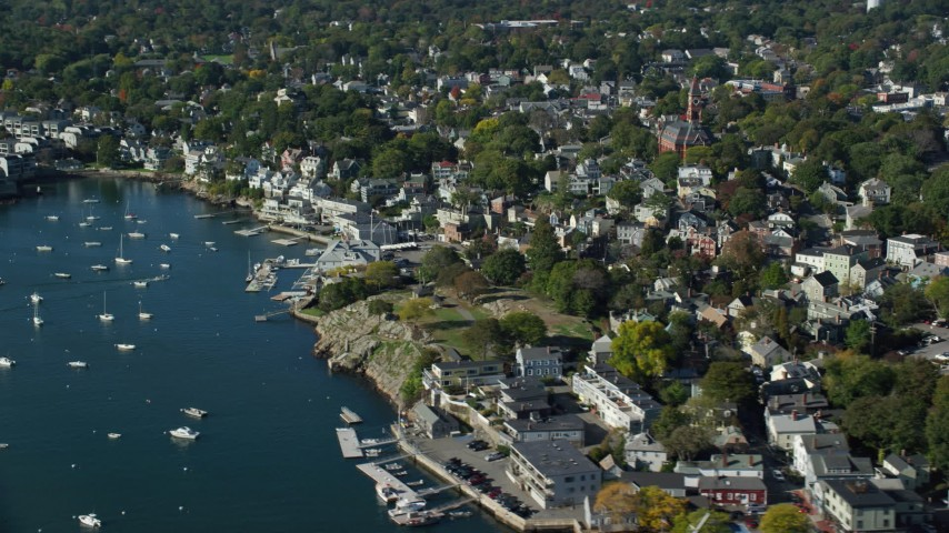 6k stock footage aerial video flying away from coastal community and harbor, Marblehead, Massachusetts Aerial Stock Footage | AX147_026