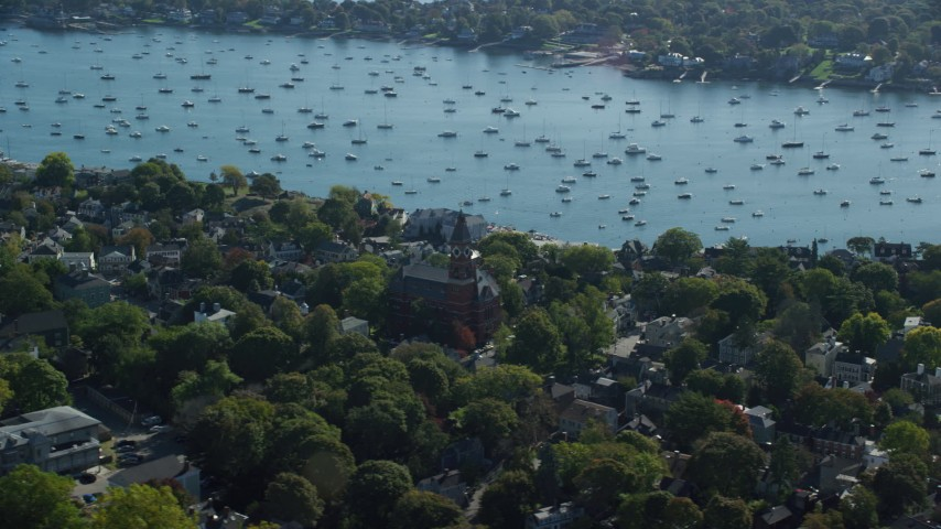 6k stock footage aerial video orbiting Abbott Hall among trees along the harbor, Marblehead, Massachusetts Aerial Stock Footage | AX147_029