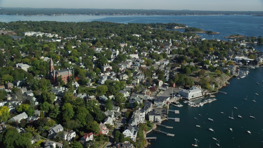 6k stock footage aerial video flying along the shores of a coastal community, Marblehead, Massachusetts Aerial Stock Footage | AX147_031