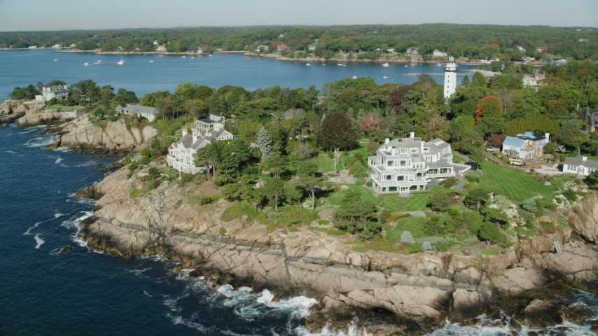 6k stock footage aerial video orbiting away from oceanfront mansions among fall foliage, Manchester-by-the-Sea, Massachusetts Aerial Stock Footage | AX147_063