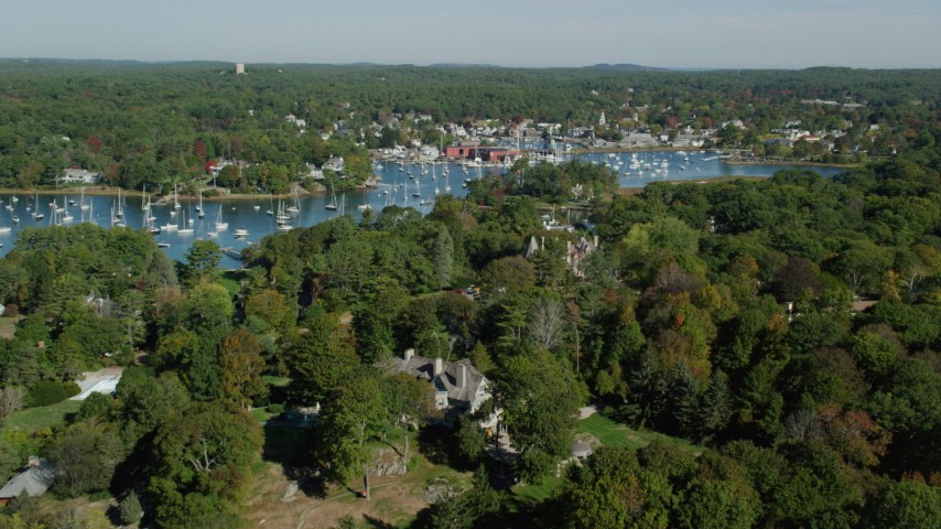 6k stock footage aerial video flying over fall foliage toward the harbor and coastal community, Manchester-by-the-Sea, Massachusetts Aerial Stock Footage | AX147_066