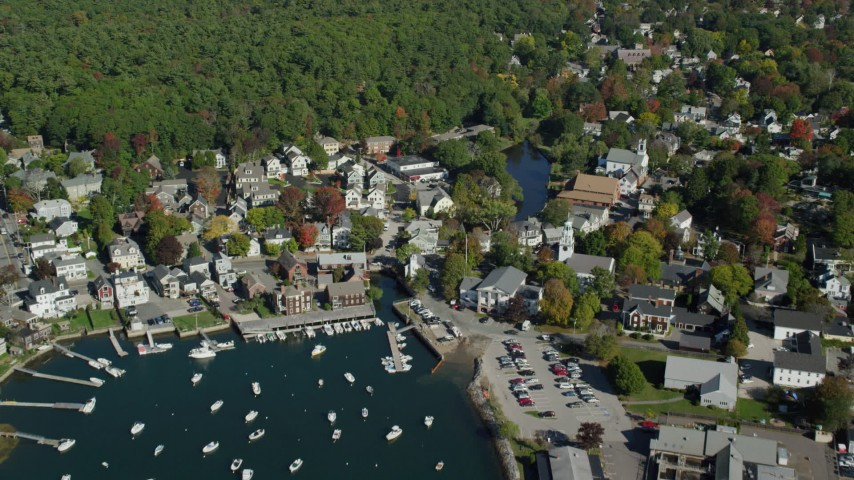 6k stock footage aerial video flying over harbor and coastal community toward trees, autumn, Manchester-by-the-Sea, Massachusetts Aerial Stock Footage AX147_068 | Axiom Images