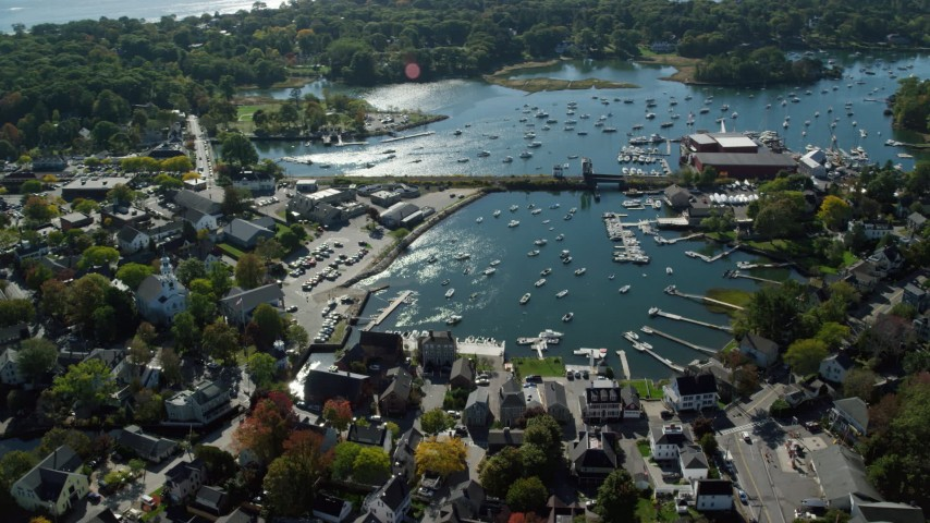 6k stock footage aerial video flying away from a coastal community and harbor, autumn, Manchester-by-the-Sea, Massachusetts Aerial Stock Footage | AX147_069
