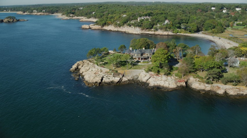 6k stock footage aerial video orbiting an oceanfront mansion, Manchester-by-the-Sea, Massachusetts Aerial Stock Footage | AX147_077
