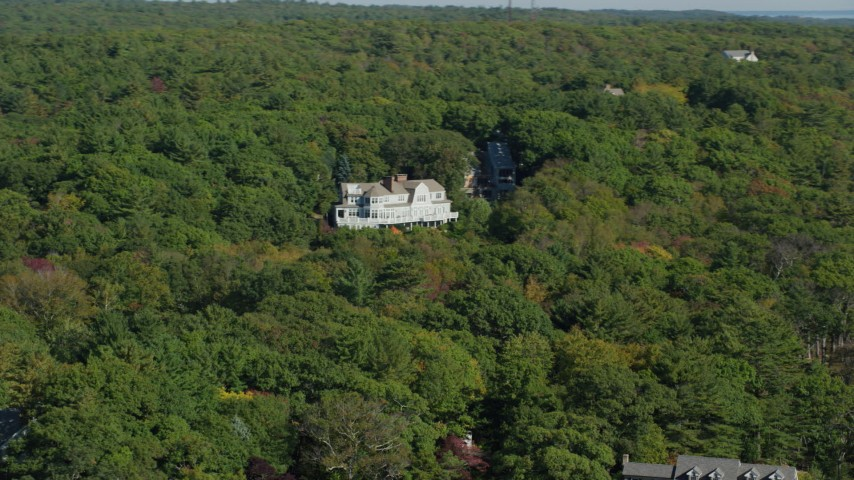 6k stock footage aerial video flying by mansion, dense trees, autumn, Manchester-by-the-Sea, Massachusetts Aerial Stock Footage | AX147_078