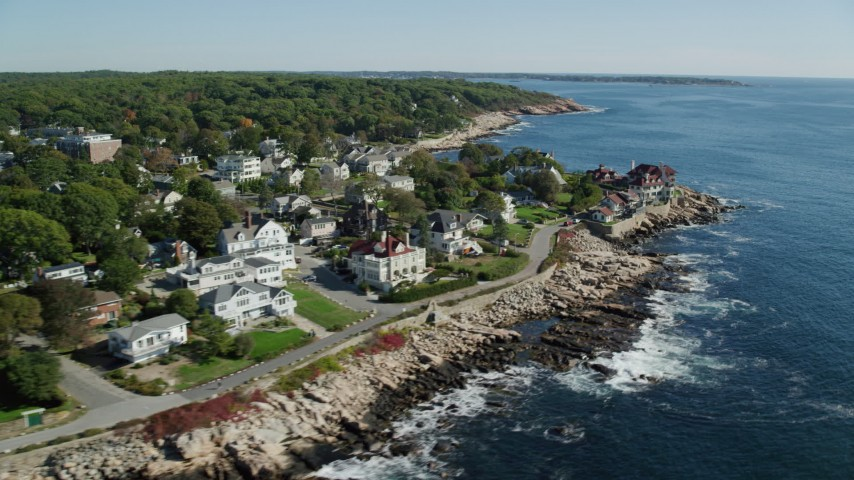 Flying by oceanfront homes, mansion, Gloucester, Massachusetts Aerial Stock Footage   AX147_080