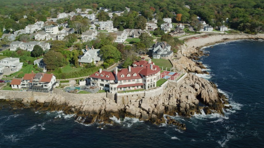 Flying by oceanfront homes, mansion, Gloucester, Massachusetts Aerial Stock Footage | AX147_080