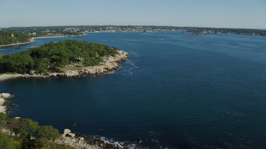 Fly by coastal town, approach Gloucester Harbor, Gloucester, Massachusetts Aerial Stock Footage | AX147_082