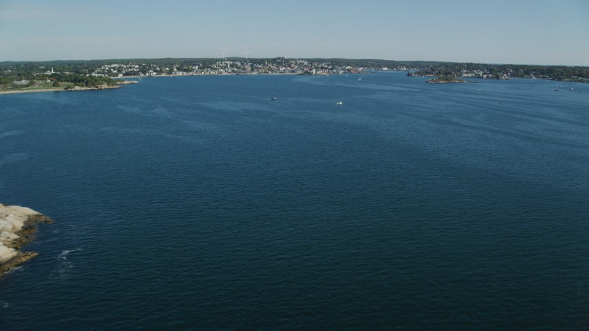 Fly over Gloucester Harbor, approach coastal town, Gloucester, Massachusetts Aerial Stock Footage | AX147_083