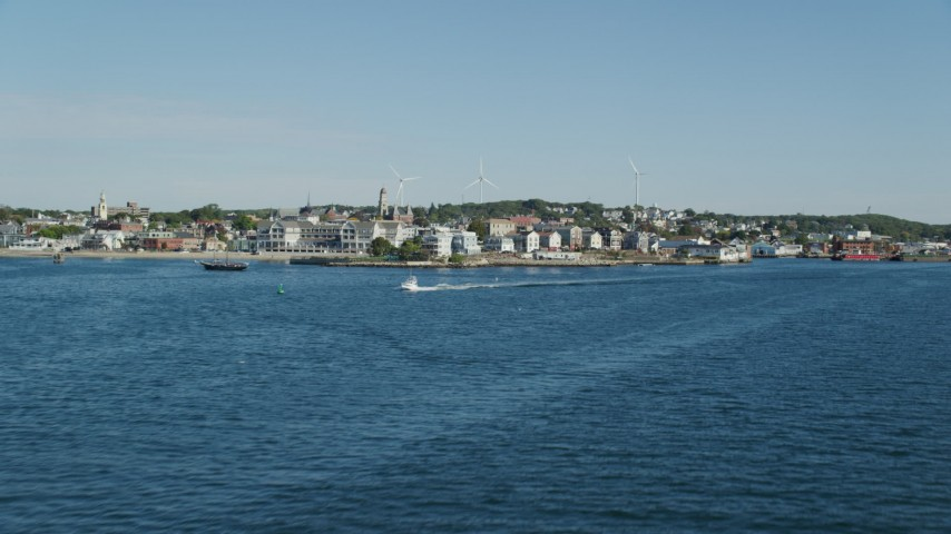 Approaching coastal town with large windmills, Gloucester, Massachusetts Aerial Stock Footage | AX147_086