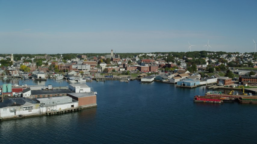 6k stock footage aerial video flying by coastal town, small warehouse buildings, Gloucester, Massachusetts Aerial Stock Footage | AX147_087