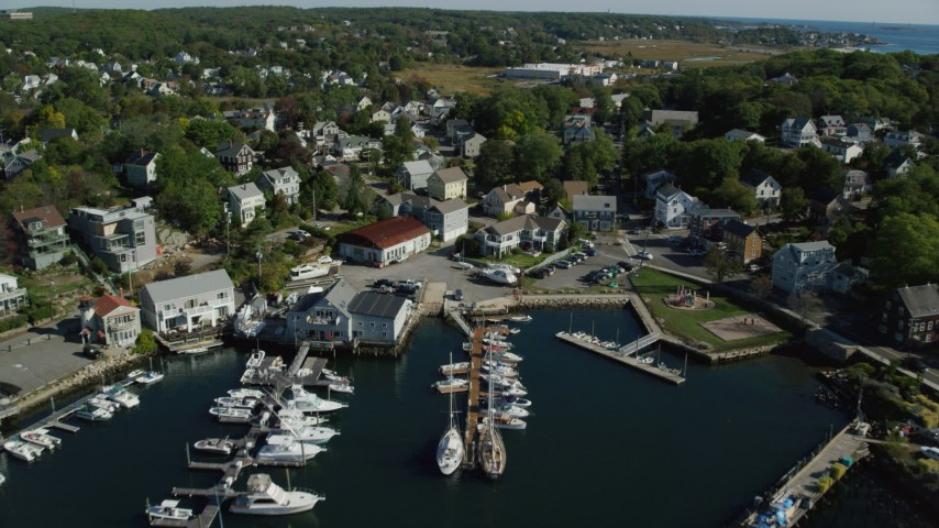 6k stock footage aerial video flying over a small harbor, approach coastal town, Gloucester, Massachusetts Aerial Stock Footage | AX147_089