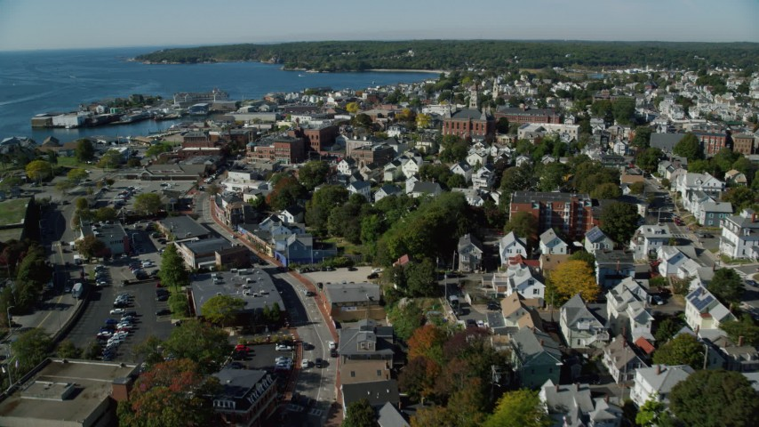 6k stock footage aerial video flying by coastal town, Gloucester City Hall, Gloucester, Massachusetts Aerial Stock Footage | AX147_093