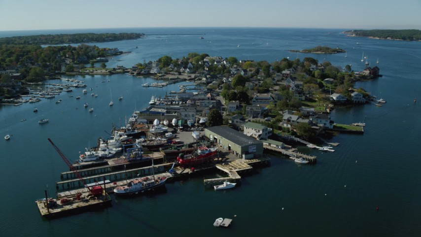 6k stock footage aerial video flying by a small coastal town, piers, Gloucester, Massachusetts Aerial Stock Footage | AX147_094