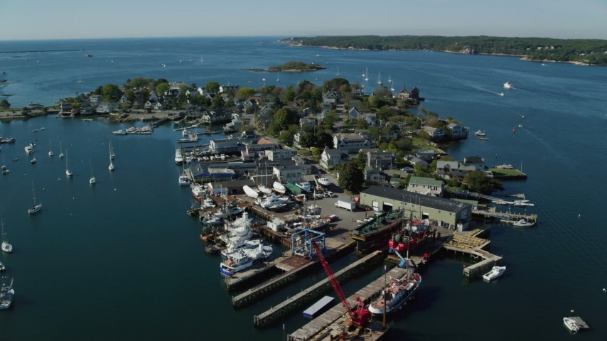Flying by small coastal town, small harbor, Gloucester, Massachusetts Aerial Stock Footage   AX147_095