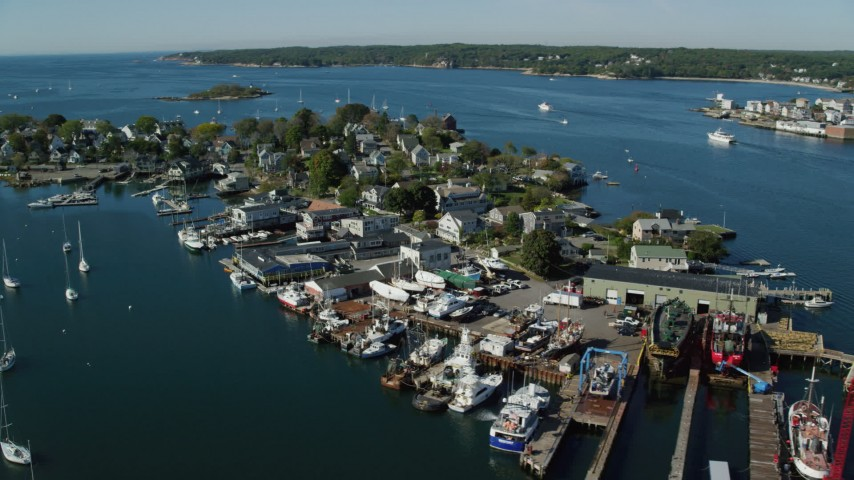 6k stock footage aerial video flying by small coastal town, small harbor, Gloucester, Massachusetts Aerial Stock Footage | AX147_095
