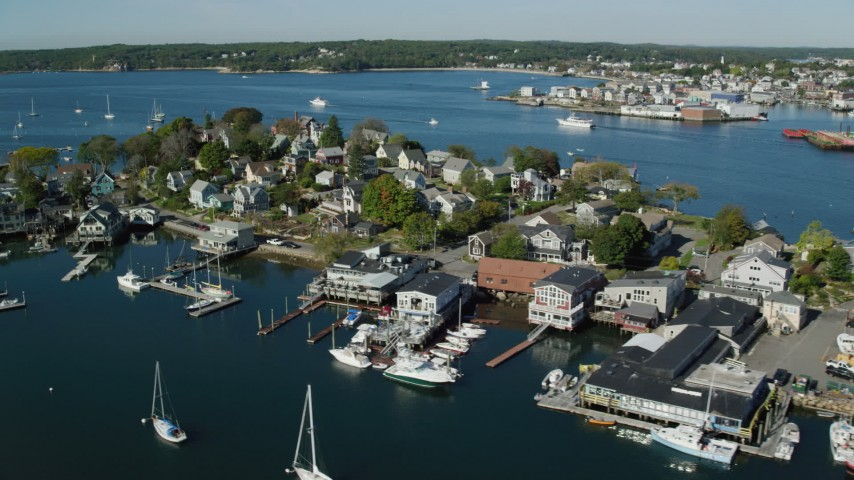 6k stock footage aerial video flying by a small coastal town and harbor, Gloucester, Massachusetts Aerial Stock Footage | AX147_096