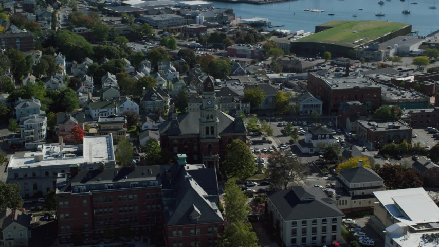 Orbiting Gloucester City Hall, coastal town, reveal harbor, Gloucester, Massachusetts Aerial Stock Footage | AX147_100