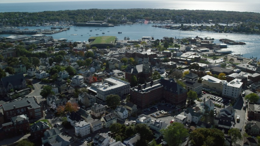Orbiting away form a city hall in a coastal town, Gloucester, Massachusetts Aerial Stock Footage   AX147_101