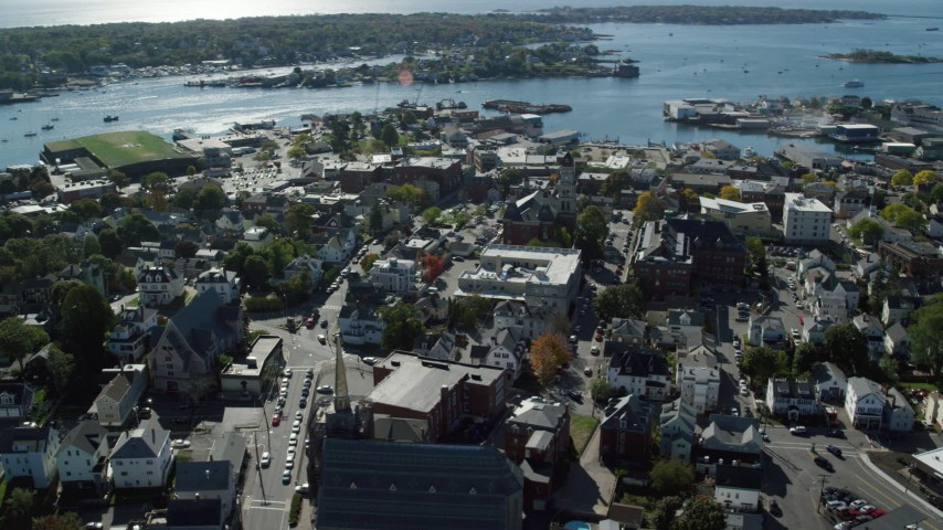 Orbiting away form a city hall in a coastal town, Gloucester, Massachusetts Aerial Stock Footage | AX147_101